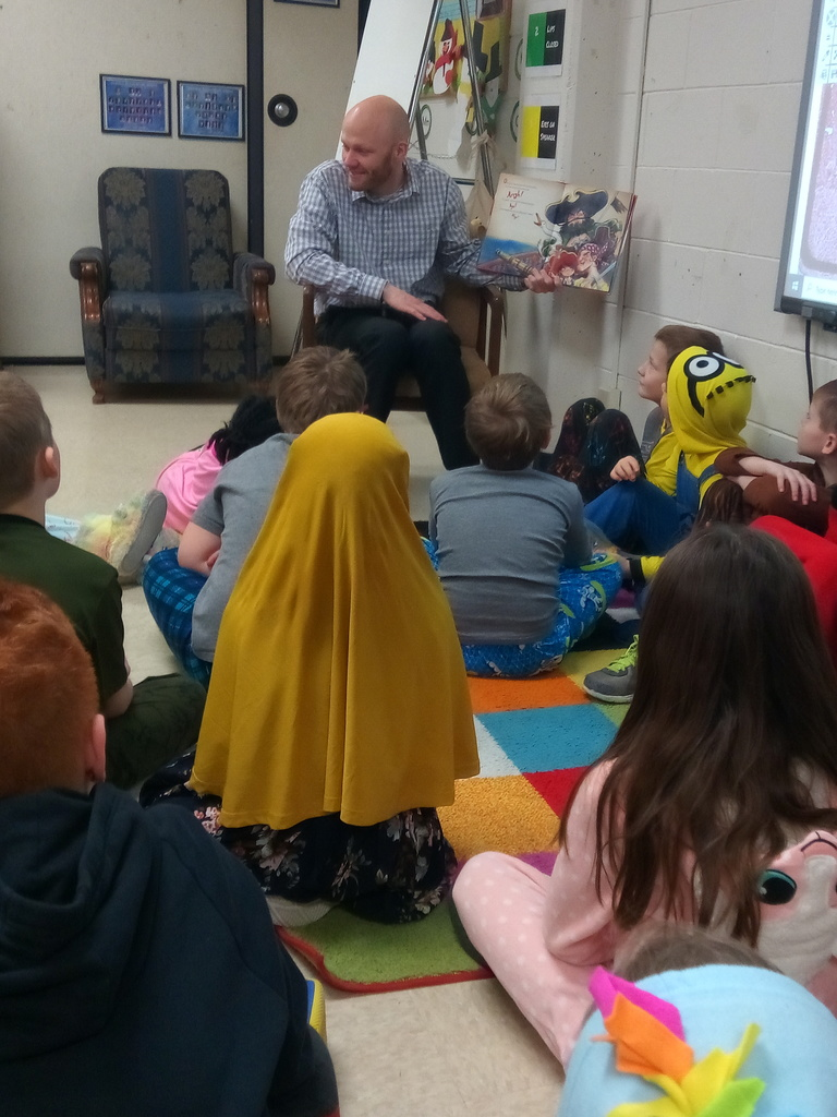 Mr Daugs reading to the class
