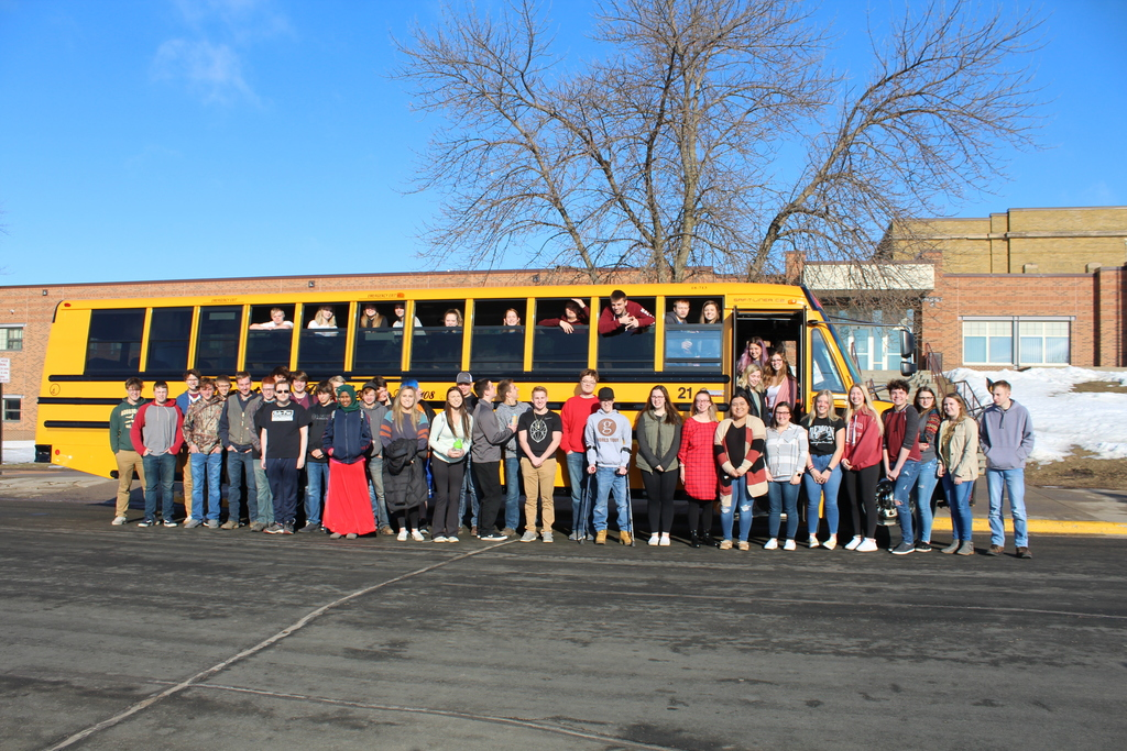 senior class in front of bus