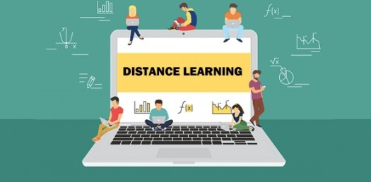 distance learning laptop with students studying